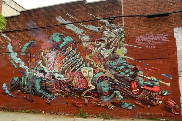 his insanely detailed painting of some sort of dissected cyborg animal was the result of Nychos and Smithe collaborating in Bushwick, Brooklyn. It was the first time these two had worked together and saying their styles compliment each other is surely an understatement.